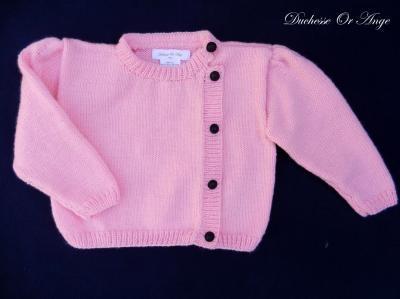 Bright pink knitted cardigan with black buttons - 2 years old
