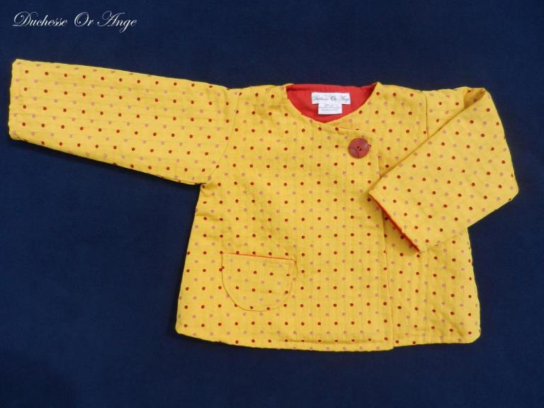 Bright yellow coat with red and pink polka dots - 2 years old