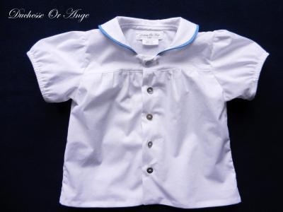 White shirt with round collar lined with blue piping - 2 years old