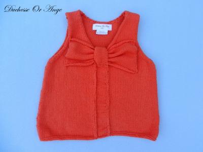 Sleeveless orange knit top with bow - 4 years old