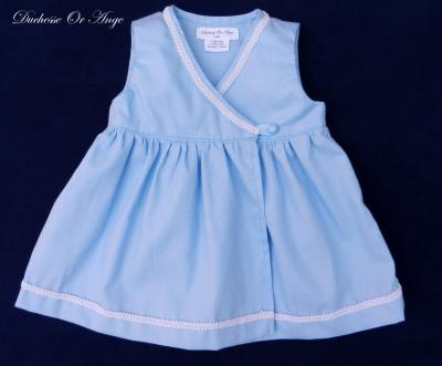 Blue wrapover baby dress bordered with white edging - 12 months old