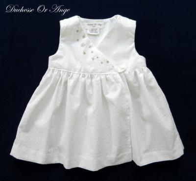 White eyelet wrapover baby dress with silver handmade embroidery - 12 months old