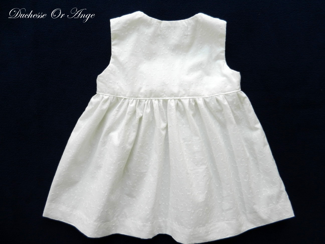 White eyelet wrapover baby dress with silver handmade