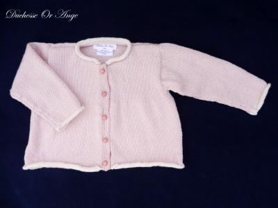 Pink knitted cardigan lined with cream - 12 months old