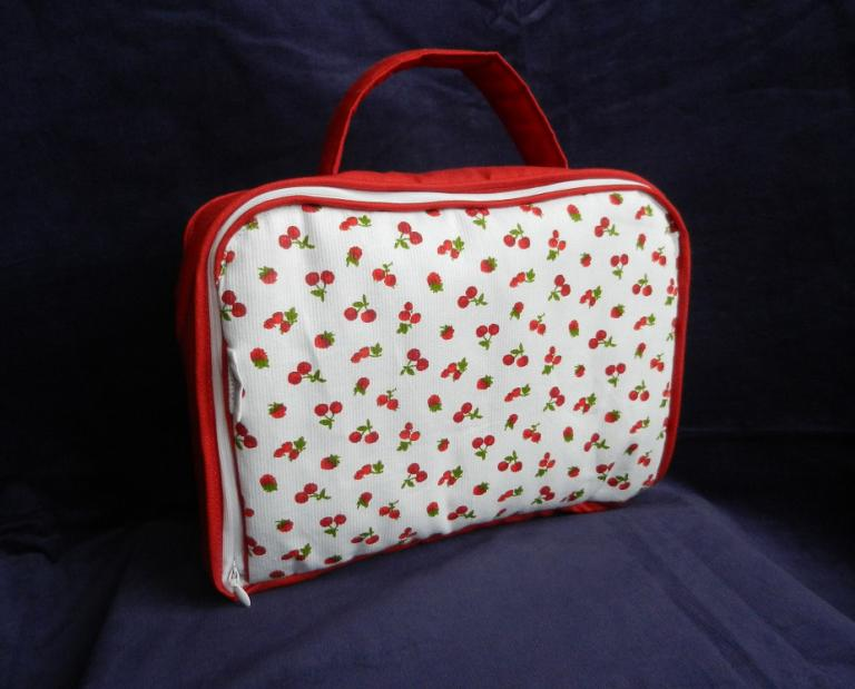Red and white padded baby suitcase in cherries and red fruit print
