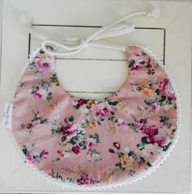 Reversible baby bib with pink roses fabric and burgundy fabric