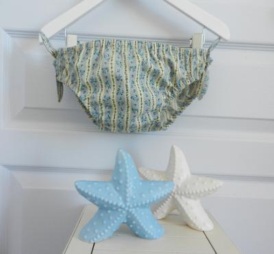 Yellow and blue floral cotton girl swimming bloomer with bows at the sides - 6 years old