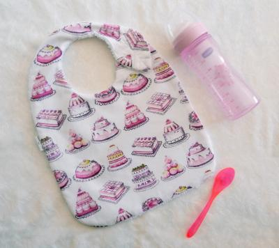 Leaf baby bib with pink cakes print fabric