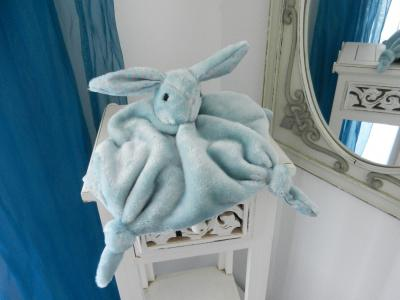 Blue rabbit baby comforter lined with grey fabric with blue polka dots