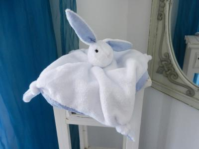 White rabbit baby comforter lined with blue cotton fabric