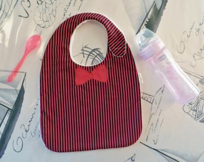 Red and navy stripes baby bib with red bow applique