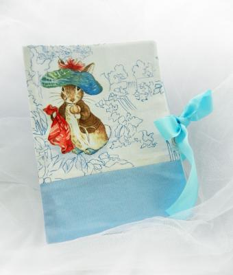 Health record book cover in Beatrix Potter fabric featuring a rabbit