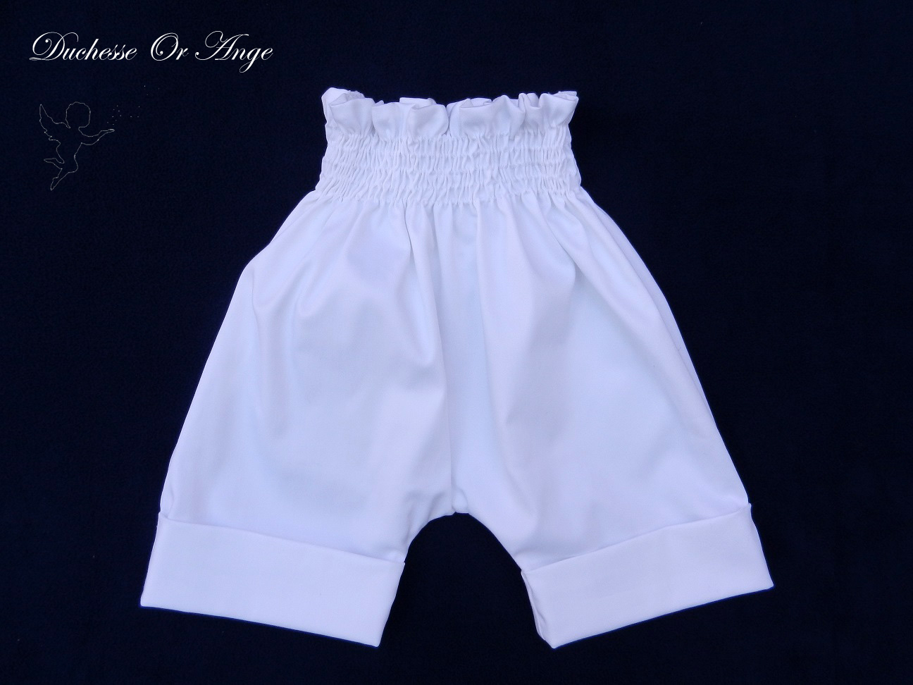 Doa 112 a pantalon court blanc 6 mois white short trousers 6 months old