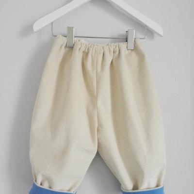 Pantalon en velours milleraies écru doublé de coton bleu - 12 mois