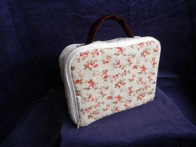 Beige padded baby suitcase in small orange roses print