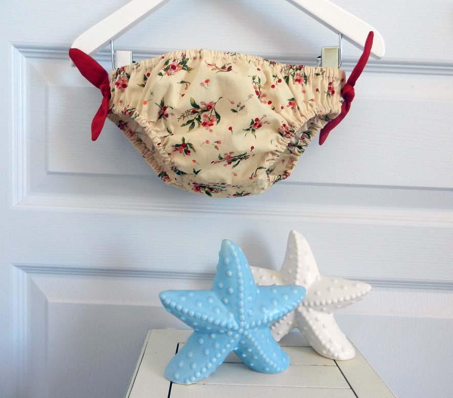 Duchesse or ange 238 a maillot de bain bebe enfant fille fillette jaune fleurs rouges noeud rouge
