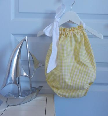 Yellow gingham baby bathing suit with white ribbon