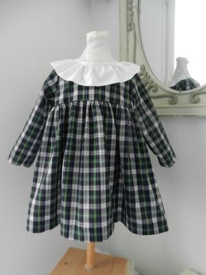 Light green and black tartan dress with white frilled collar