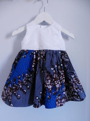 Sleeveless dress with lace white top and wax blue skirt