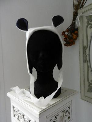 Warm off white woollen hood with two small ears, dark purple velvet lining