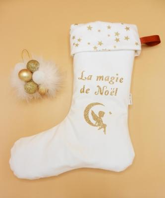 Botte de Noël blanche et revers à étoiles dorées