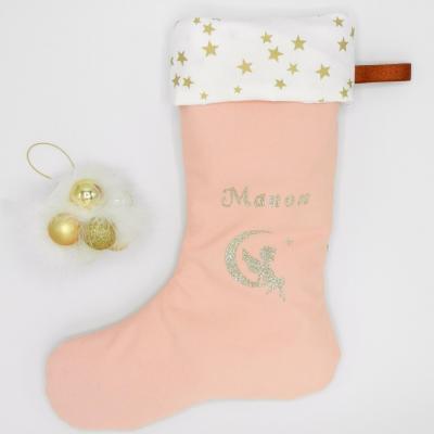 Botte de Noël rose et étoiles dorées