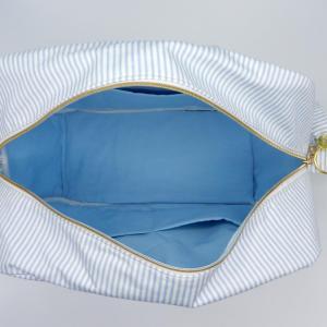 Duchesse or ange doaa 92 sac a langer rayures bleues et blanches motif bebe avec doudous d