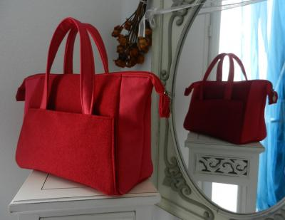 "Small ""Boudoir"" bag in red fluffy fabric."